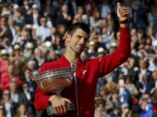 Novak Djokovic holds the trophy after winning the final of the French Open tennis tournament against Andy Murray at the Roland Garros stadium in Paris, France. Photo: AP/PTI