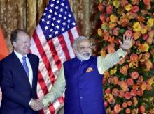 Prime Minister Narendra Modi  waves and shakes hands with USIBC Chairman John Chambers, Executive Chairman, Cisco, at the U.S.-India Business Council (USIBC) 41st annual Leadership Summit in Washington