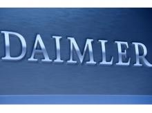 A Daimler sign name is pictured during the company's annual news conference in Stuttgart, Germany