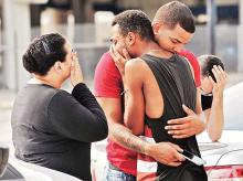 Friends and family members of victims of nightclub shooting outside the Orlando Police headquarters  on Sunday | Photo: Reuters