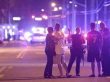 Orlando Police officers direct family members away from a multiple shooting at a nightclub in Orlando, Florida. Photo: AP/PTI