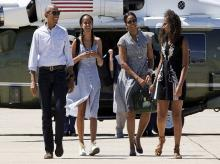 President Barack Obama, Malia Obama, Michelle Obama and Sasha Obama walk to board Air Force One after leaving Yosemite National Park via helicopter after visiting the park to celebrate the 100th anniversary of the creation of US national park system.