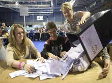 A ballot box is opened for counting at the Titanic Exhibition Centre in Belfast, Northern Ireland, as counting gets underway in the referendum on the UK membership of the European Union. Photo:AP/PTI