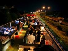 People dine on a double-decker bus which has been converted to a mobile restaurant as it travels through the streets of Ahmedabad (Photo: Reuters)