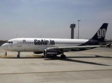 A GoAir aircraft taxis on the tarmac at Bengaluru International Airport in Bangalore