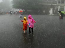 Children enjoy monsoon rains