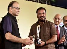 Finance Minister Arun Jaitley gives Lakshmipati Singhania-IIM Lucknow National Leadership Award to Anand Kumar, founder of Super 30 in New Delhi.