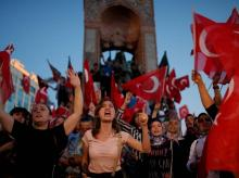 People chant slogans as they gather at a pro-government rally in central Istanbul's Taksim square