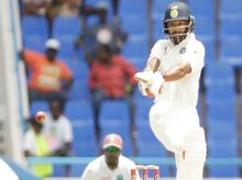 India's Shikhar Dhawan plays a shot during day one of the first cricket Test match against West Indies at the Sir Vivian Richards Stadium in North Sound, Antigua. Photo: BCCI Twitter Handle