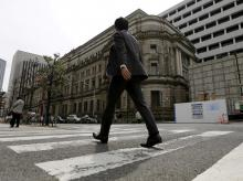 A businessman walks past the Bank of Japan (BOJ) building in Tokyo, Japan. Photo: Reuters