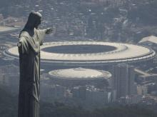 The Christ the Redeemer statue stands in front of the Maracana stadium in Rio de Janeiro, Brazil