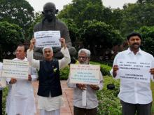 YSR Congress Party members holding a protest to demand special status for Andhra Pradesh at Parliament House during the ongoing monsoon session in New Delhi
