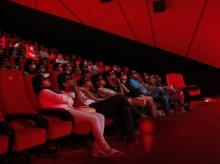 A file photo of cinema-goers wearing 3D glasses watch a movie at a PVR Multiplex in Mumbai