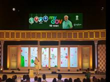 Prime Minister Narendra Modi speaks at his first Townhall meeting with citizens at the Indira Gandhi Indoor Stadium in New Delhi. Photo: MyGovIndia Twitter Handle