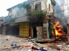 Shops torched by angry protestors after clashes between two communities in Chhapra, Saran district of Bihar.