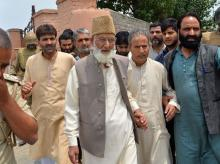 Syed Ali Shah Geelani being taken into custody Photo courtesy: Twitter user @need4geeks