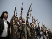 Tribesmen loyal to Houthi rebels hold their weapons as they chant slogans during a gathering aimed at mobilizing more fighters into battlefronts in several Yemeni cities in Sanaa, Yemen.