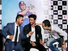 Ace Cricketer M S Dhoni and Bollywood actor Sushant Singh along with Director Neeraj Pandey during the trailer launch of the movie 'MS Dhoni - The Untold Story' in Mumbai.