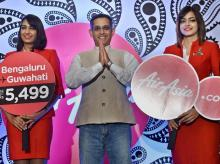 Air Asia India CEO Amar Abrol with Airlines hostesses during a press conference to announce the fleet and route expansion plans in Bengaluru