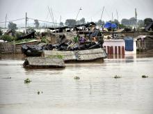 Houses submerged with flooded water of River Ganga in Patna