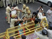 Police detain Congress workers and supporters at the party's Jan Akrosh Rally in Gandhinagar