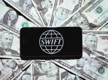 SWIFT discloses cyber thefts, pressures banks on security
