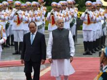 Narendra Modi with his Vietnamese counterpart Nguyen Xuan Phuyc during his ceremonial reception at the Presidential palace in Hanoi, Vietnam