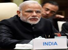 Prime Minister Narendra Modi speaks during the BRICS meeting at the West Lake State Guest House in Hangzhou, China.
