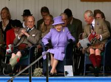 Britain's Queen Elizabeth II, centre, accompanied by Prince Philip, the Duke of Edinburgh, left and Prince Charles, attend the Braemar Royal Highland Gathering, at the Princess Royal and Duke of Fife Memorial Park in Braemar, Scotland.