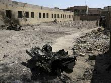 Remains of car bombs litter a school yard used as a cemetery for deceased Islamic State group fighters in Fallujah, 40 miles (65 km) west of Baghdad, Iraq.