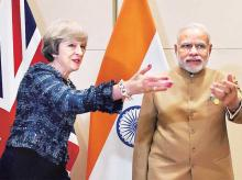 Prime Minister Narendra Modi with UK Prime Minister Theresa May at the G20 summit in Hangzhou, China, on Monday | Photo: Ppti
