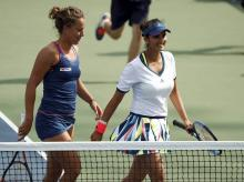 Sania Mirza,(right) with her doubles partner Barbora Strycova, of the Czech Republic