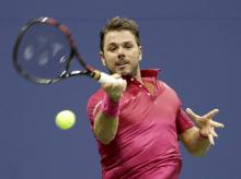 Stan Wawrinka, of Switzerland, hits the ball during his match against Juan Martin del Potro, of Argentina, during the quarterfinals of the US Open