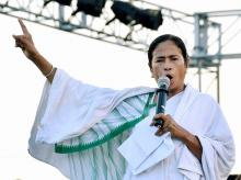 West Bengal chief minister Mamata Banerjee addresses farmers during a programme at Singur