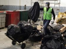 Workers from an environmentally-friendly rubbish disposal business called ScrapApp sort through garbage in a shopping mall in Noida