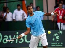 India's Ramkumar Ramanathan in action against Spain's Feliciano Lopez during the Davis Cup World Group Play off match. Photo: PTI