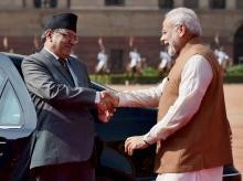 Prime Minister Narendra Modi greets Nepalese counterpart Pushpa Kamal Dahal during a ceremonial reception at Rashtrapati Bhavan in New Delhi