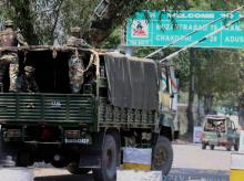 Army personnel in vehicles move inside the Uri Army Brigade Camp in Uri, Jammu and Kashmir.