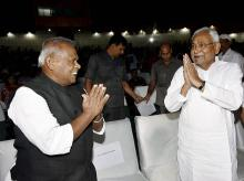 Bihar Chief Minister Nitish Kumar with Ham(S) Chief Jitan Ram Manjhi at a function in Patna. Photo:PTI