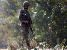 An Indian army soldier patrols along a highway on the outskirts of Srinagar. Photo: Reuters