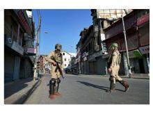 CRPF Jawans stand guard during the curfew and strike in Srinagar. (Photo: PTI)