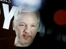 Julian Assange, Founder and Editor-in-Chief of WikiLeaks speaks via video link during a press conference on the occasion of the ten year anniversary celebration of WikiLeaks in Berlin, Germany. Photo: Reuters