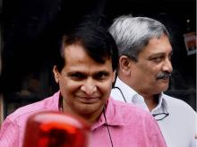 Union Railway Minister Suresh Prabhu and Defence Minister Manohar Parrikar after a Cabinet meeting at South Block in New Delhi. Photo: PTI
