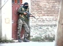 An army jawan takes position during an attack on army camp at Langate in Kupwara. (Photo: Twitter/@ANI_news)