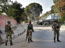 CRPF personnel stand guard during a curfew in Srinagar. (Photo:PTI)