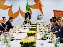 Narendra Modi with Michel Temer during a meeting with the business leaders of the two countries in Goa