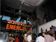 Rescue team in action at SUM Hospital where a fire broke out on Monaday night. (Photo: PTI)