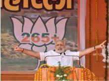 PM Narendra Modi addressing his Parivartan Maharally in Mahoba.Photo: PTI