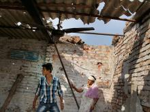 Villagers show a damaged roof house due to alleged shelling from across the LoC  at the India-Pakistan International border in Bidipur village of RS Pura sector, newar Jammu. (Photo: PTI)