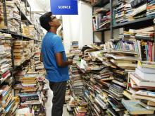 A customer at the new Blossom bookstore in Bengaluru